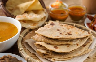 Jaipur | Chapati or Flat bread, roti canai, Indian food, made from wheat flour dough. Roti canai and curry. copy