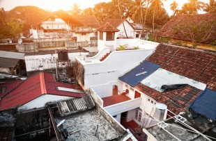 View to the roofs at sunrise background in fort Kochin, Kerala copy