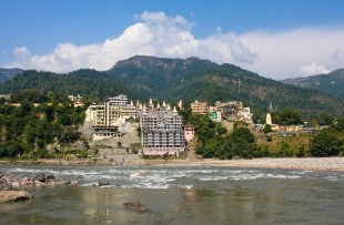 Holy Ganges river that flows through Rishikesh (the world capital of Yoga) - the holy city for the Hindus, India. copy